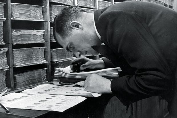 Detective looking at fingerprints