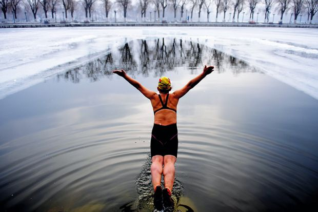 Diving into a cold lake