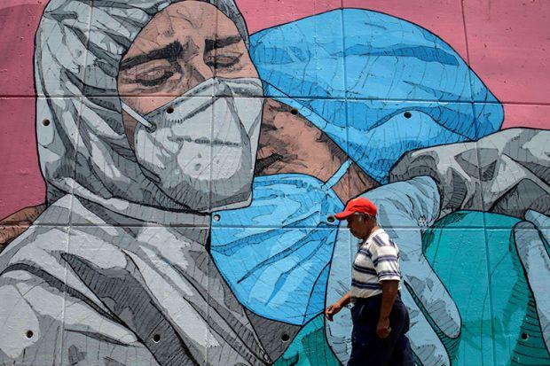 Mural of medics embracing