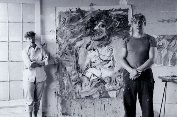 Elaine and Willem de Kooning standing in front of painting