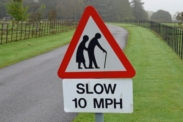 Elderly in the road sign
