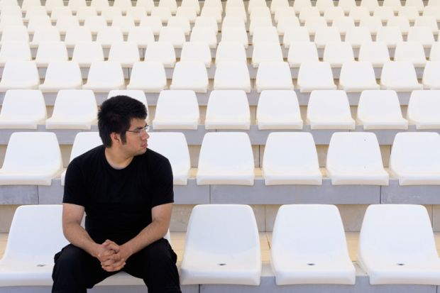 Man in empty stadium