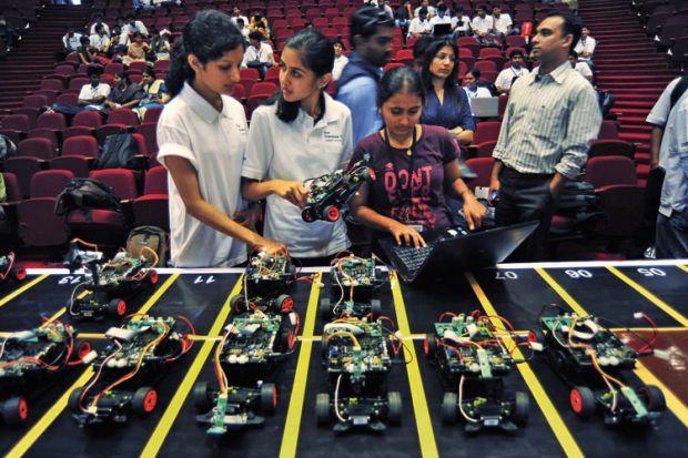 Engineering students prepare smart car race, Bangalore, 2011
