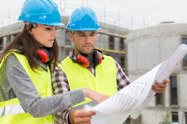Exceptional Engineers On Building Site Checking Plans
