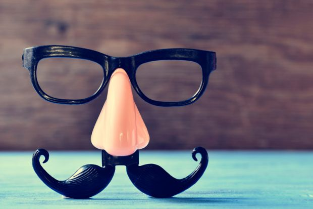 Fake nose and moustache eye glasses placed on table