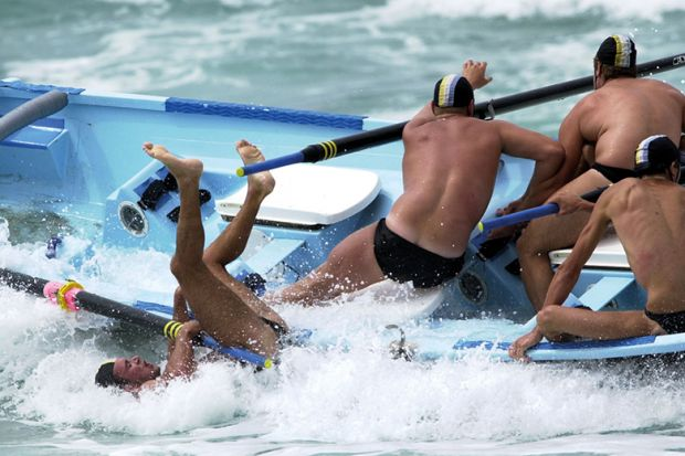 men fall off boat