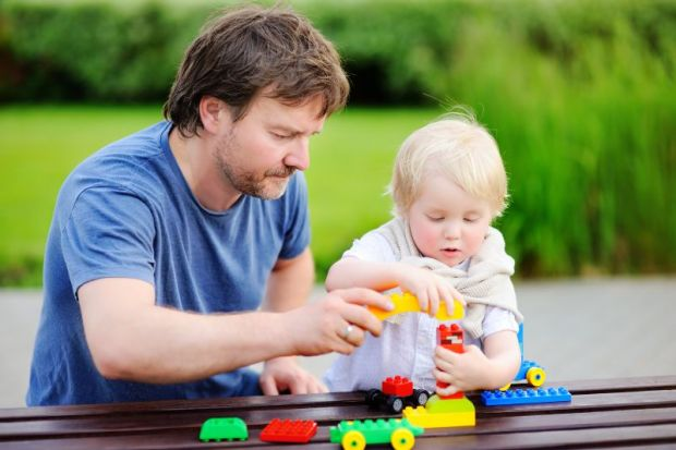 Father and child playing with blocks