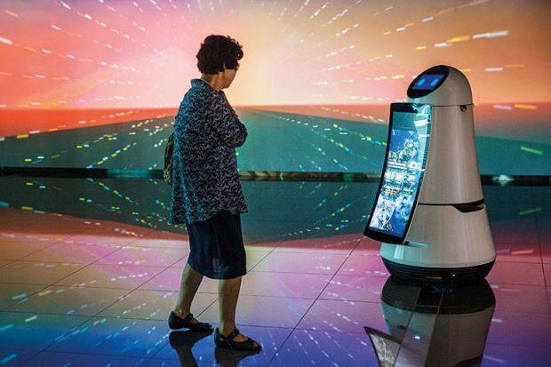 Woman looking at robot