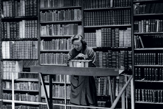 Female librarian at work