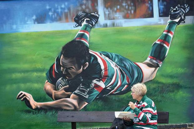 female-rugby-fand-and-mural