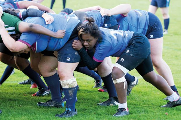 Female rugby player in scrum
