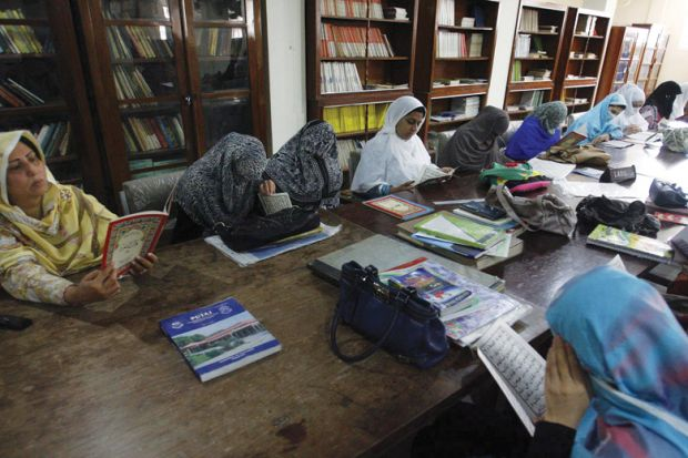 Female students reading in Peshawar University library