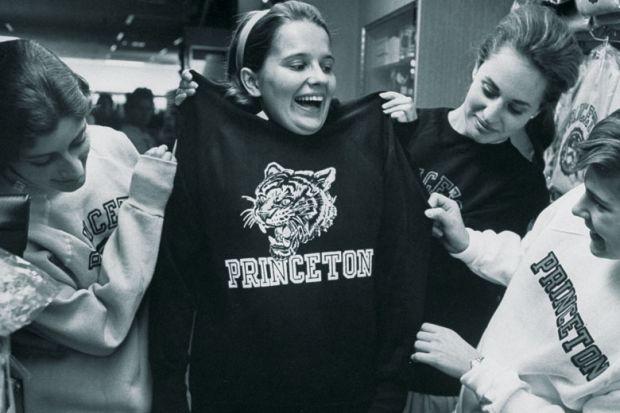 Female students shopping for Princeton University sweatshirts