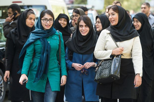 Female students walking on campus, University of Tehran, Iran