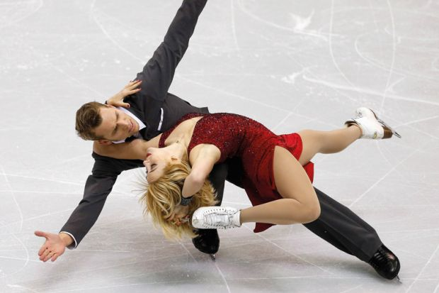 Figure skaters striking pose during competition