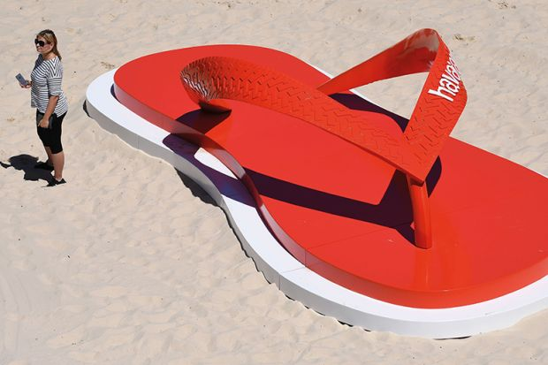 Giant flip flop on beach