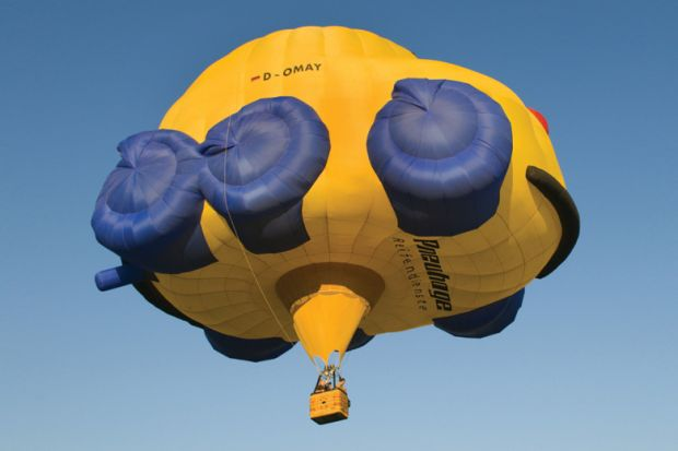 Flying hot-air balloon shaped as car, Rhineland-Palatinate, Germany