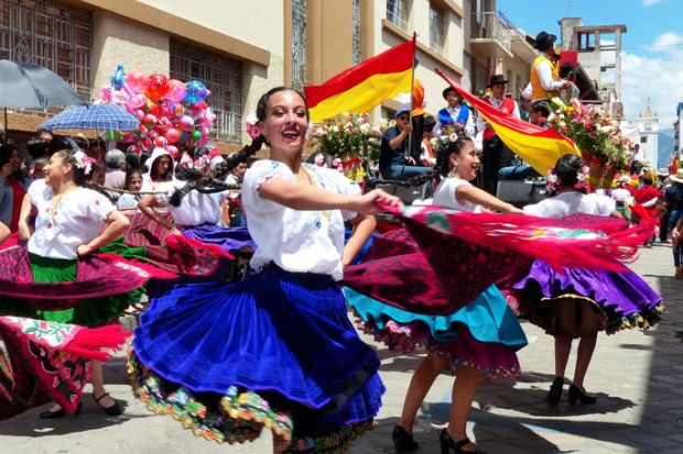Folk dancers at the parade, Cuenca, Ecuador