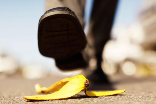 Foot about to step on banana peel