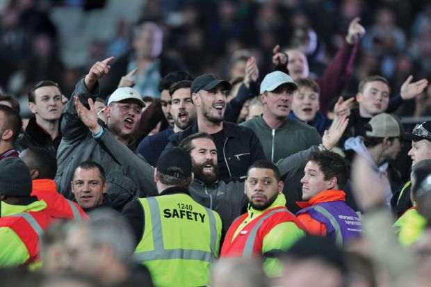Football fans taunt fans of opposing side