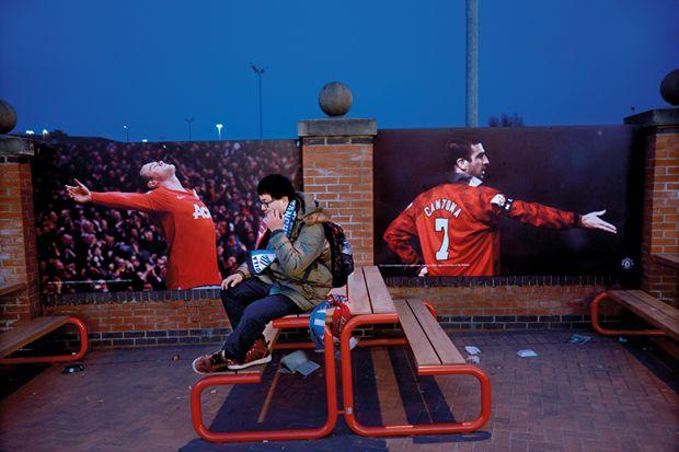 football fan sitting alone