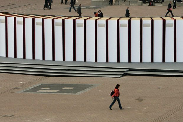 Visitors walk past giant books at the Frankfurt Book Fair. Germany