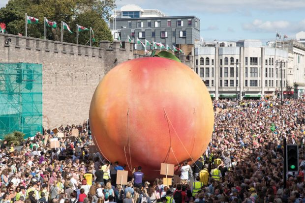Giant peach being moved through Cardiff streets