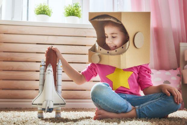 Girl in astronaut costume