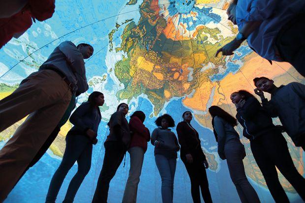 people inside world globe