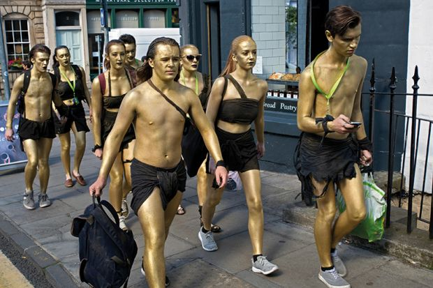 People with gold spray paint on their bodies