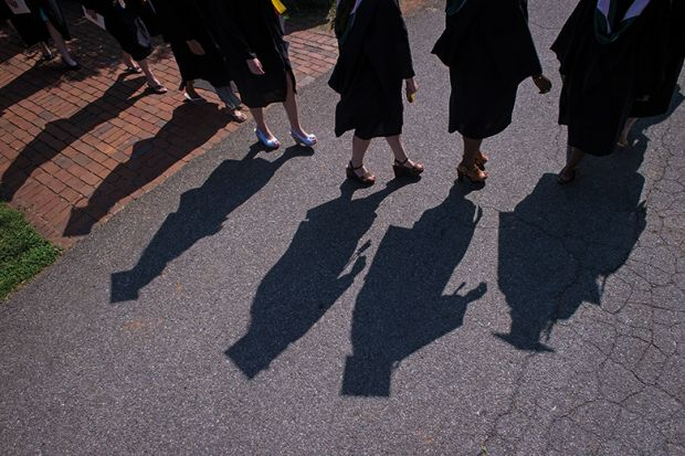 Shadows of graduates at liberal arts college US