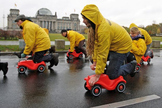 Greenpeace activists protesting, Reichstag building, Berlin