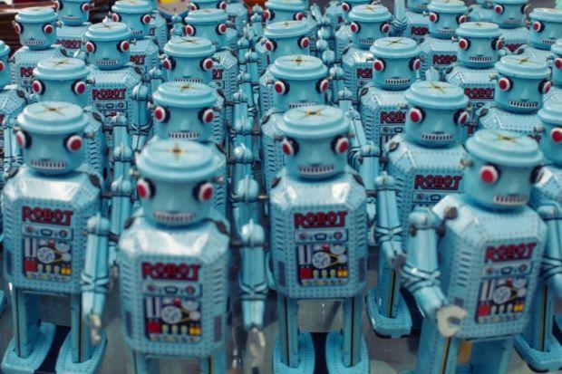 Group of blue robots facing camera