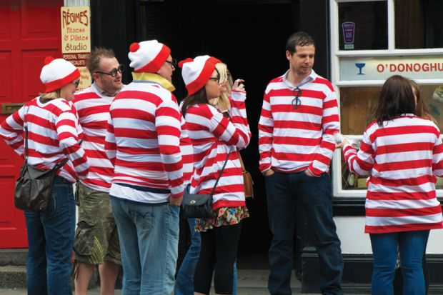 Group of identically-dressed tourists sightseeing in Dublin