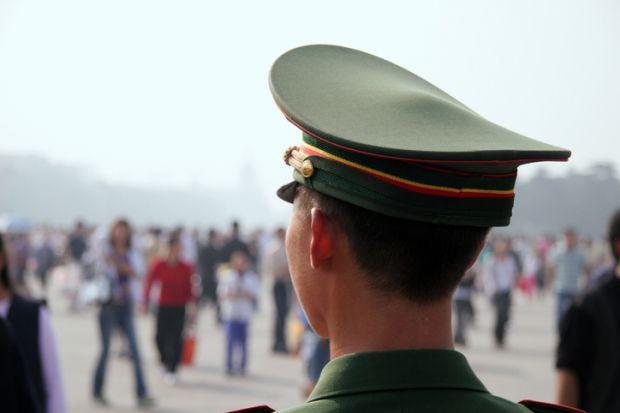 Guardian Officer at Tiananmen Place, China illustrating surveillance of international students