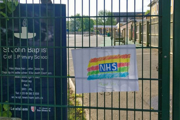 Hand drawn rainbow with thank you note to NHS displayed on fence