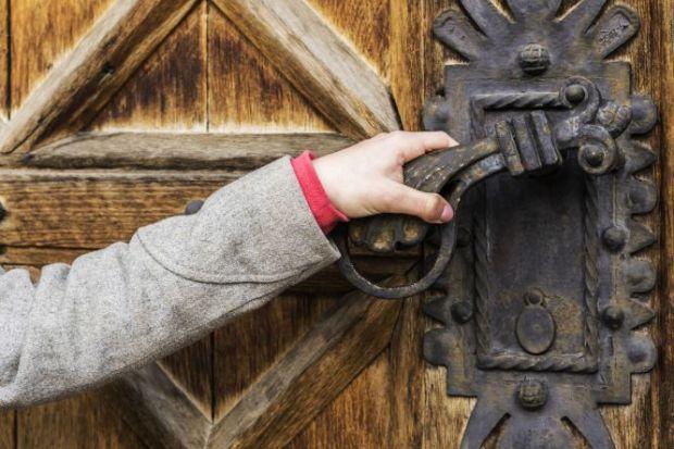 Hand opening old door