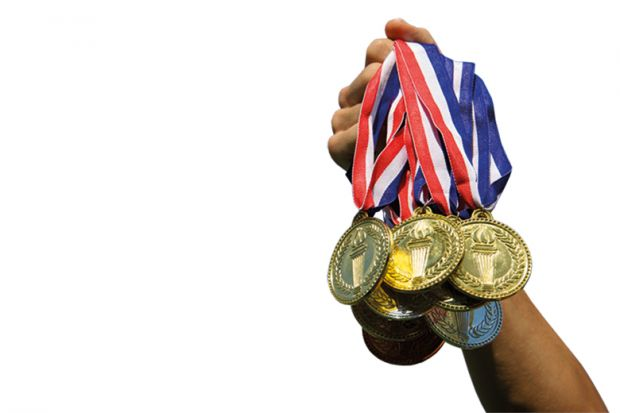 Someone holding gold medals