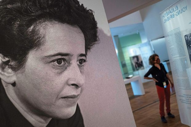 """A photograph of German-American philosopher and political theorist Hannah Arendt (L) is on display during a press preview of the exhibition """"Hannah Arendt and the Twentieth Century"""" at the German Historical Museum"""