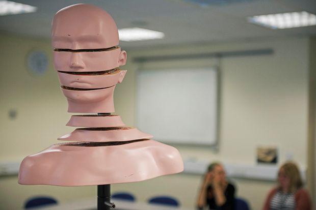 Cut head sculpture