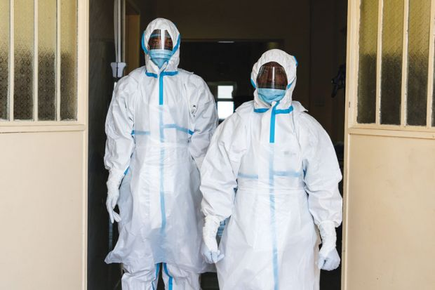 Health workers wearing protective clothing