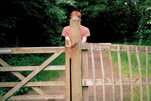 hiding behind gate post