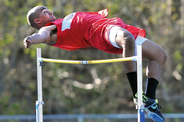 man doing high jump to illustrate predicted grades
