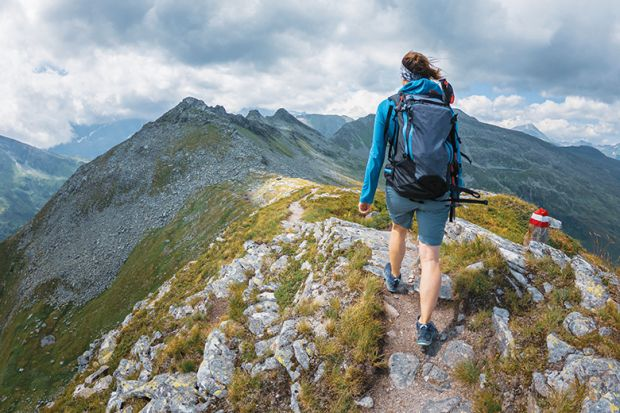 woman hiking to illustrate taking time out