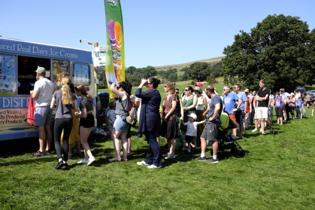 Hope, Derbyshire, UK. August 26, 2019. Families of spectators at a country show queuing for ice cream in the beautiful peak district countryside at the Hope show in Derbyshire, UK.