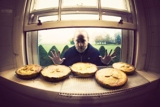 Hungry man looking longingly at row of pies