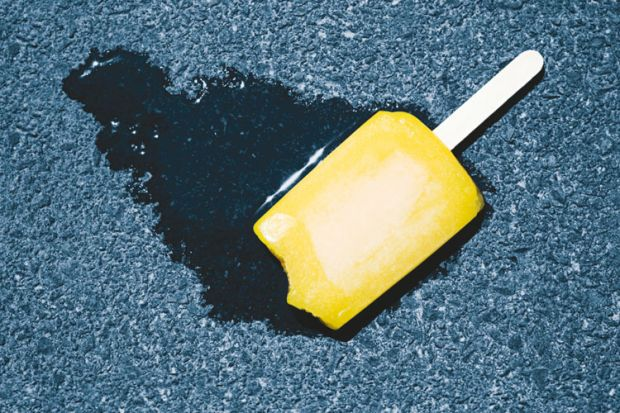 Ice lolly melting on pavement concrete