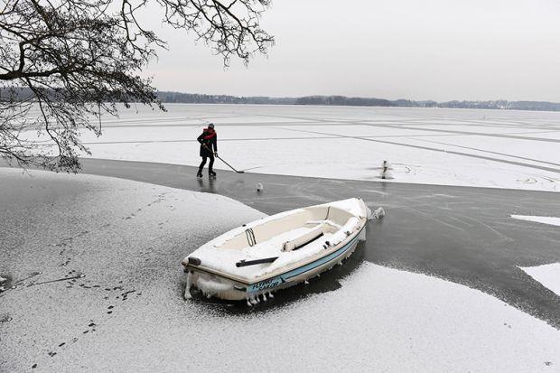 practising hockey on frozen lake