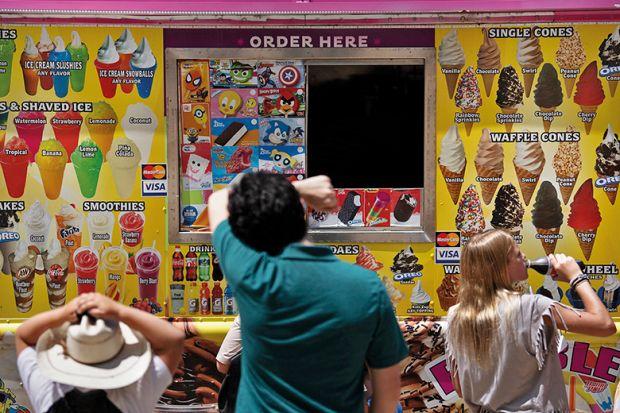 People at ice cream van