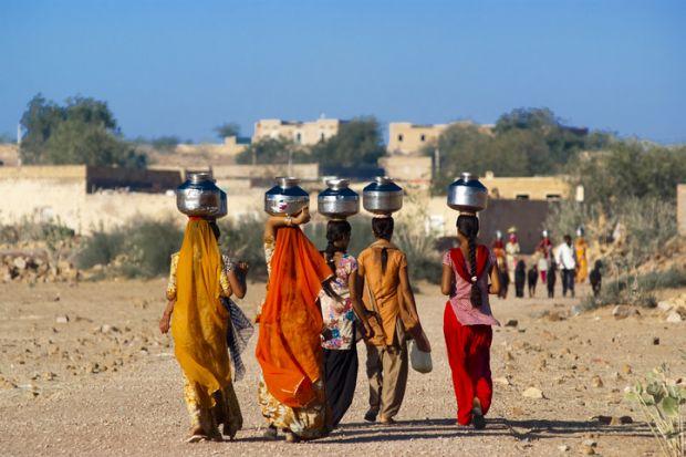 Indian women carrying water pots